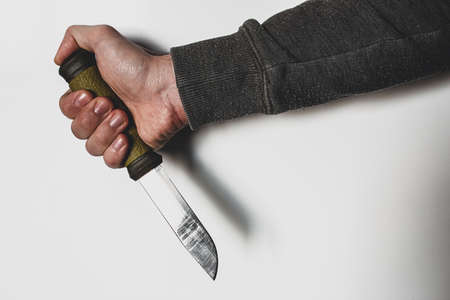 hand and knife on white background concept of violence, crime Stock Photo