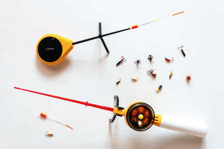 winter fishing rods and jigs on a white background Stock Photo