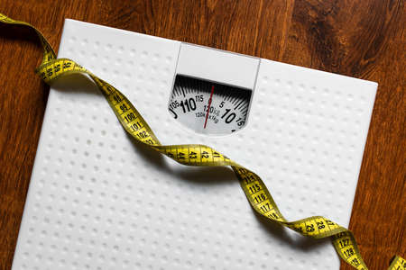 scales and measuring tape diet concept Stock Photo