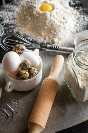 rolling pin, flour and eggs - ingredients and utensils for baking and cooking