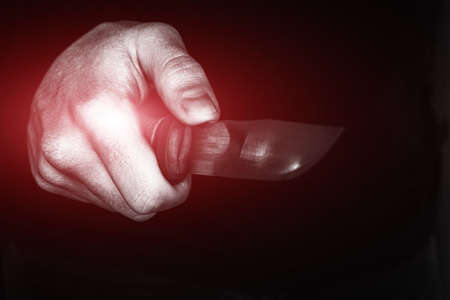 hand with a knife close up concept theft, murder, crime
