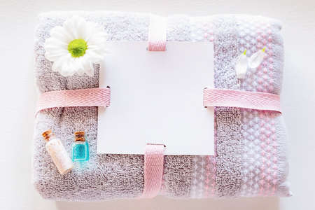 spa towel with place for text and natural home made cosmetics close up
