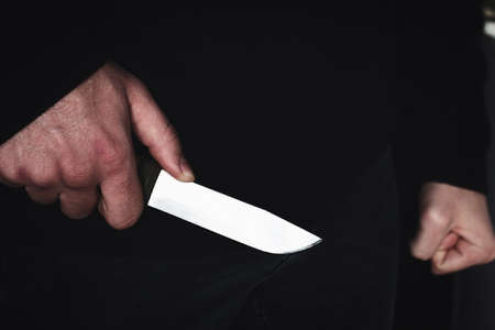 robber killer criminal with a knife in hand close up Stock Photo