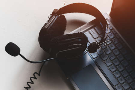 headphones on laptop keyboard concept remote work, distance education