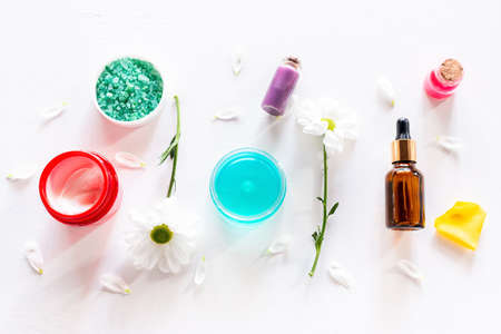 home cosmetics cream perfume oil on white background