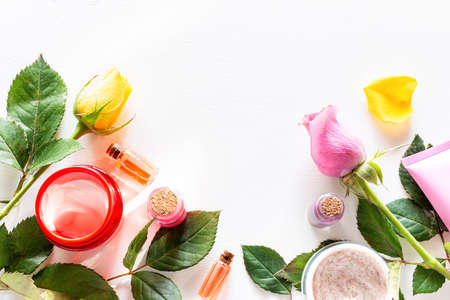 frame from natural cosmetics, spa creams and flowers on a white background template