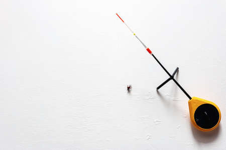 russian ice fishing rod balalaika on white background with place for text