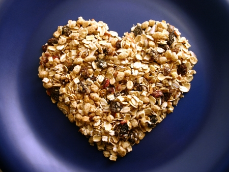 Muesli heart on a blue plate  Stock Photo