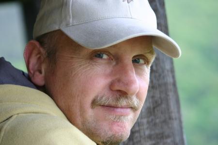 Mature man with base ball cap