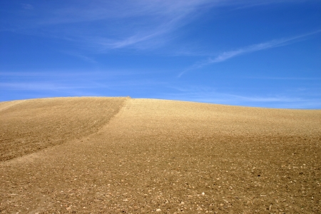 Blue sky meets brown dry earth