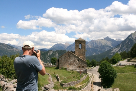 Man taking picture of Tella a little village just outside the Ordesa national park in the spanish pyranees  Stock Photo