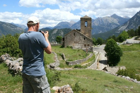chappel: Man taking picture of Tella a little village just outside the Ordesa national park in the spanish pyranees  Stock Photo