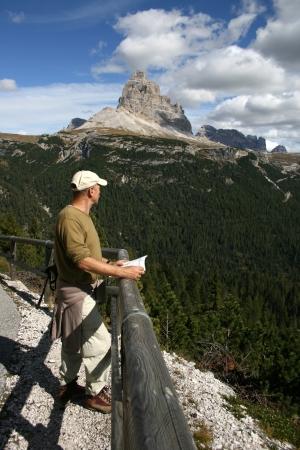 Man looking at Mountain  3 Zinnen  in Tirol Italy Stock Photo