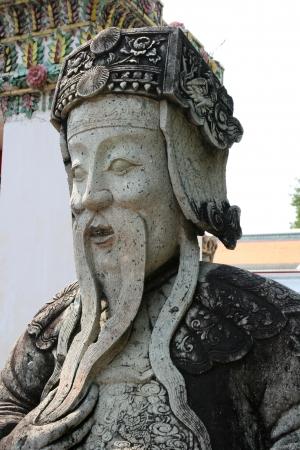 Statue of chinese guard at Wat Arun in Bangkok