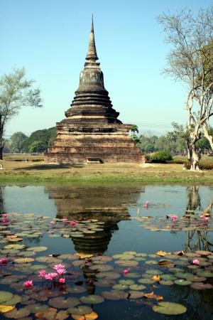 Stupa reflecting in lake at Sukhothai Thailand