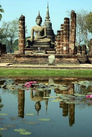 Buddha reflecting in lake at Sukhothai Thailand Stock Photo