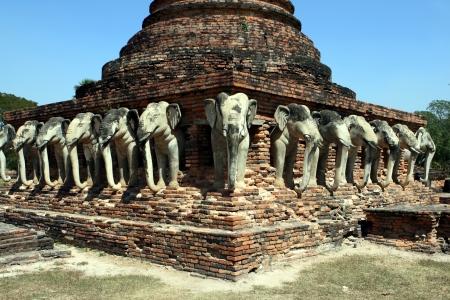 Rows of stone elephants at Sukhothai Stock Photo