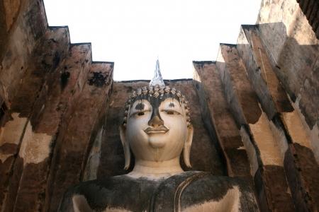 Massive Buddha statue at Sukhothai Thailand