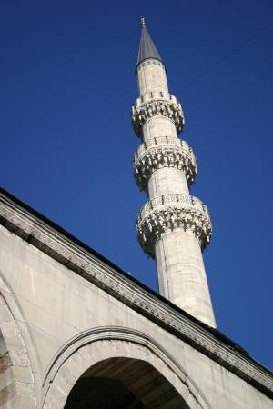 Minaret set against a deep blue sky in Istanbul