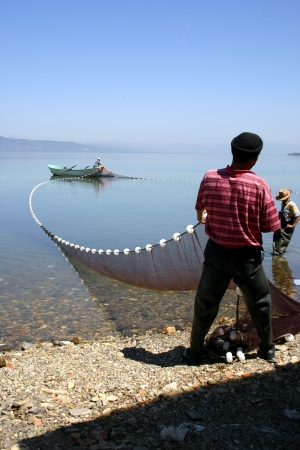 Fishermen at Lake near Iznik Turkey   Stock Photo