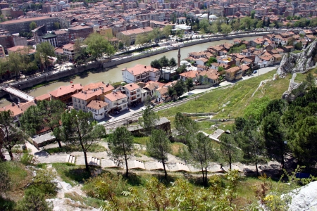 Looking down from the kings tombs over the town of Amasya surrounded by mountains and set in the valley of the Yesihrmak river  Stock Photo