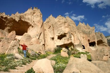 moon walker: Man standing in front of Zelve open air museum in Cappadocia, Turkey