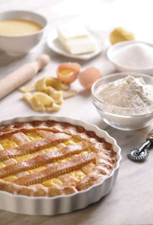 Sweet Pie / Tart on Plate, Made in Italy with Ingredients on Kitchen Counter