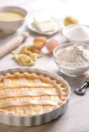 Uncooked Sweet Pie / Tart on Plate, Made in Italy with Ingredients on Kitchen Counter Stok Fotoğraf