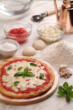 Pizza on Plate, Made in Italy with Ingredients on Kitchen Counter