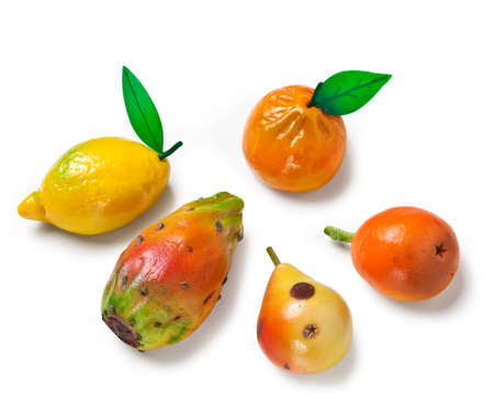Marzipan fruits on a white background
