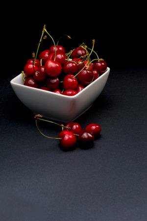 Cherries Bowl on dark background photo