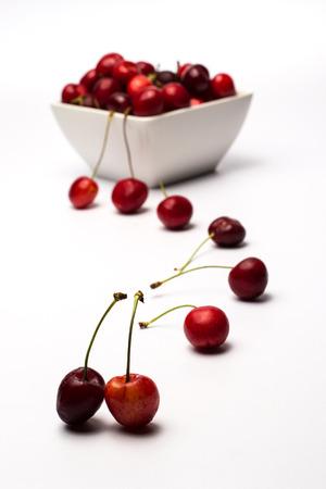 Bowl of Cherries on white background photo