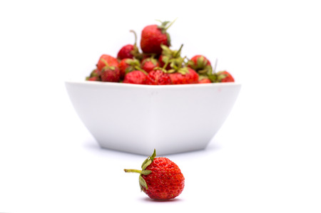 Home grown fresh strawberries on isolated background photo