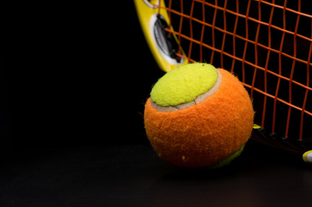 Tennis ball for kids with tennis racket photo