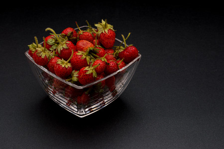 home grown: Home grown fresh strawberries on isolated background Stock Photo