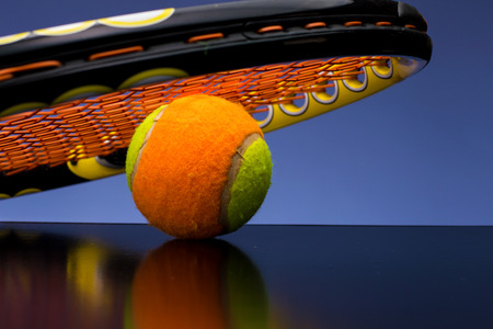 Tennis ball for children with tennis racket Standard-Bild