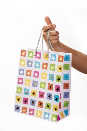 Woman holding gift bag on white isolated background photo