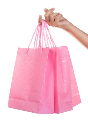 Woman holding gift bags on white isolated background photo