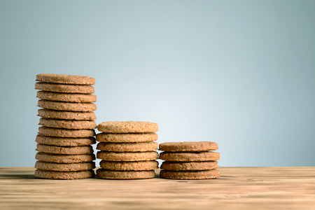 Stack of cookies on vintage wooden background photo