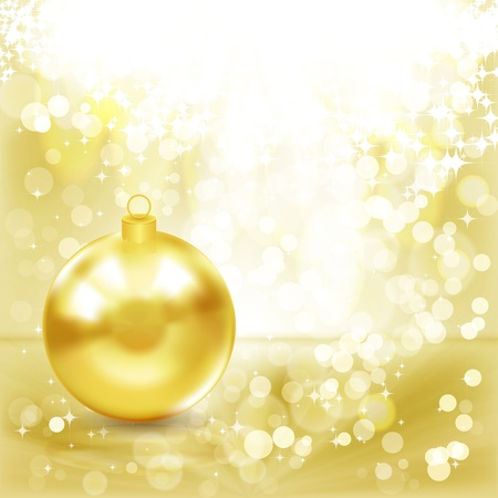 Gold Christmas ball on a golden light background. photo