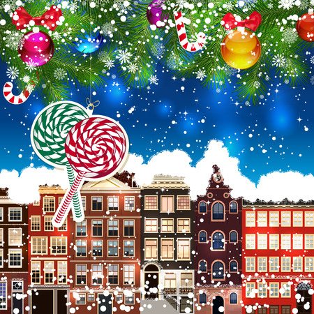 snowcovered: Christmas lollipops on the background of snow-covered streets. Green branches of Christmas trees decorated with Christmas balls and sweets. Christmas background.