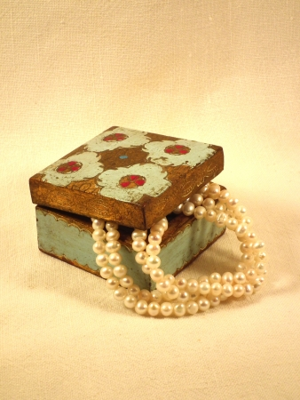 White pearl necklace in an old wooden box photo