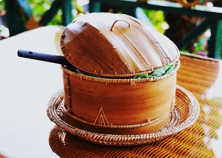 Bamboo pot on a glass table. photo