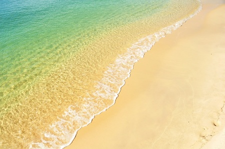 View of sea, water on the gold sand.