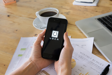 eponymous: CHIANG MAI,THAILAND - JULY 14, 2016: Uber mobile apps. Uber - Company of San Francisco, established under the eponymous mobile application for searching, calling and paying a taxi or private drivers.
