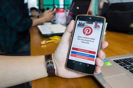 nexus: CHIANG MAI,THAILAND - MAY 20,2016 : NEXUS with social Internet service Pinterest on the screen. Pinterest is an online pinboard that allows people to pin their interesting things. Editorial