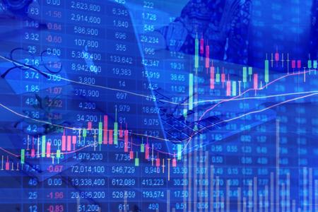 bullish market: graph chart of stock market. background finger pointing keyboard computer.
