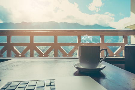Coffee time at morning with mountain view form window. Stock Photo