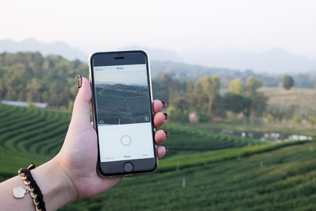 CHIANG MAI, THAILAND - DEC 12, 2016: A woman hand holding iphone with using camera of instagram application. Instagram is largest and most popular photograph social networking. Editorial