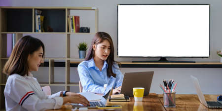 Group of Businesswoman and Accountant checking data document on laptop for investigation of corruption account . Anti Bribery concept. Stock Photo